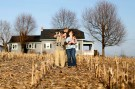 (L-R) Jeremiah Underhill is shown on the family property with son Dalton on his shoulders, wife and mother Annette, and baby Blake in her arms at their home in Richfield, Pennsylvania March 8, 2016. Picture taken March 8, 2016. To match Special Report USA-WATER/LEAD REUTERS/Gary Cameron - WASEC381SER01